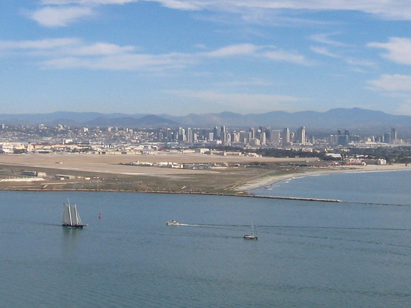 Tall ship America sails south down the channel out of the bay and into the open ocean.