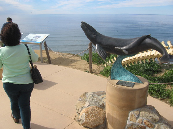 Sculpture of a gray whale and a cetacean's vertebrae along walkway that leads from the old lighthouse.
