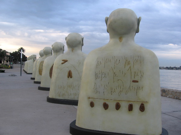Interesting, abstract designs on backs of the human-like sculptures.