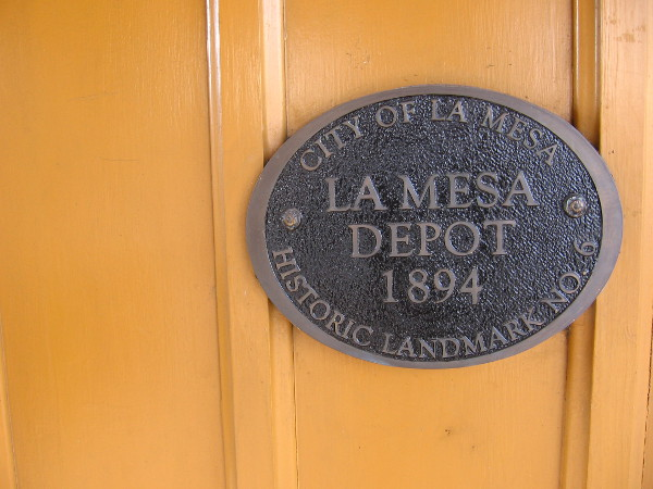 City of La Mesa Historic Landmark No. 6 on side of 1894 train depot.