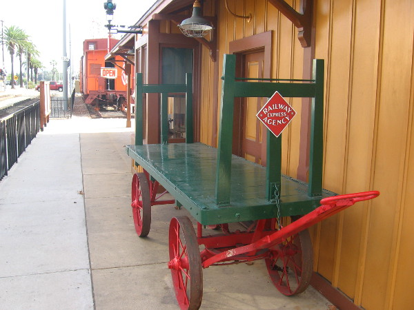 An old railway hand cart for hauling freight or luggage.