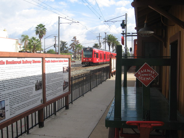Here comes the San Diego Trolley, approaching the nearby La Mesa Boulevard station.