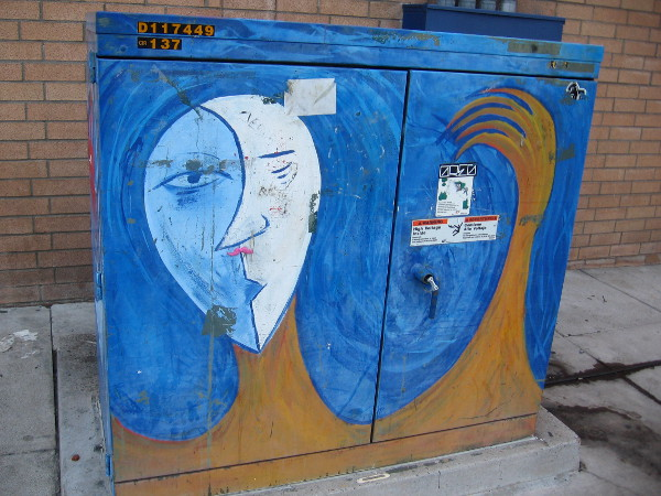 Cool abstract face on an imaginative Hillcrest utility box.