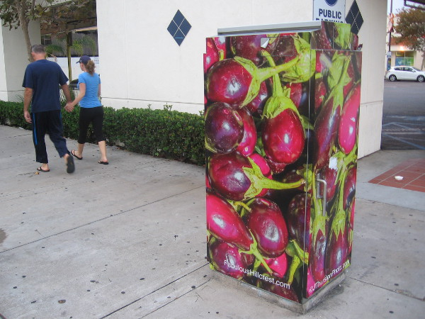 Some large utility boxes in Hillcrest feature various fruit and vegetables.