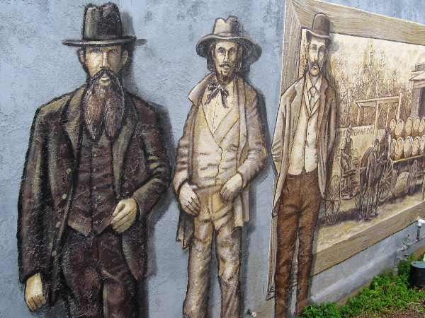 Several whiskered Western characters pose in a mural on Harney Street in Old Town.