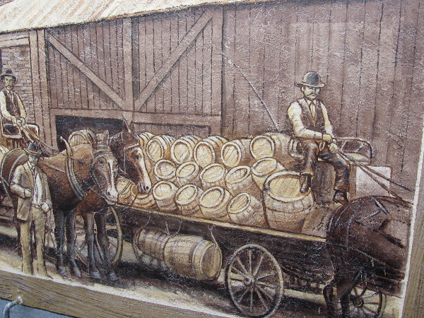 Freight wagon hauls a load of barrels in fun art that recalls early San Diego history.