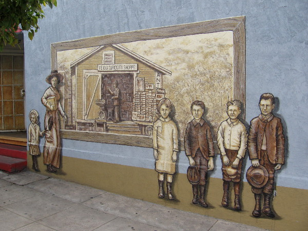 Old Town mural on building wall was painted in 2013 by artist Frank Mando.