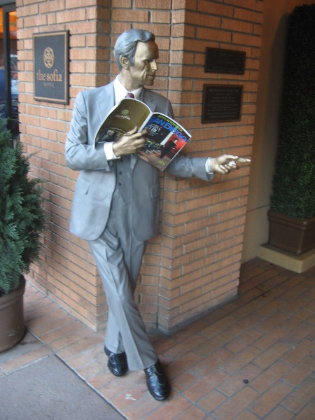 Seward Johnson's 'That A Way' sculpture at entrance of The Sofia Hotel.