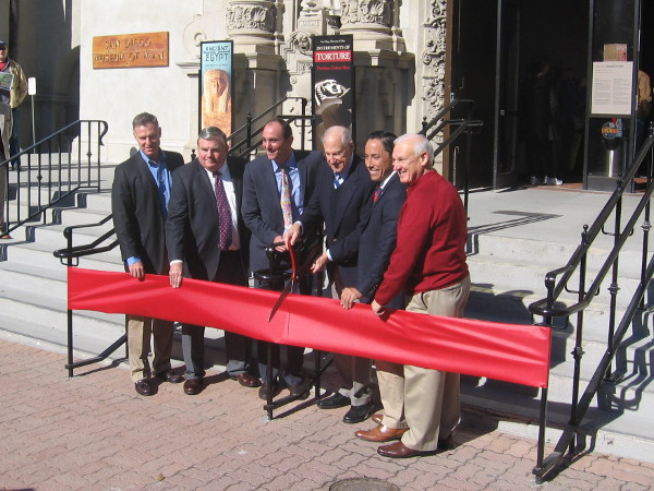 Local politicians, museum head and donor, poised ready to cut the big red ribbon!