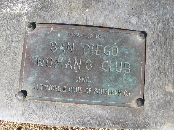 Plaque on Harbor Drive reveals nearby bell was donated by San Diego Woman's Club.