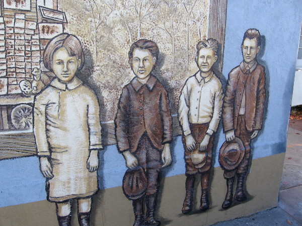 Kids standing along sidewalk seem to have materialized from San Diego's past.