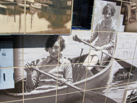 Two ladies row a pleasure boat.
