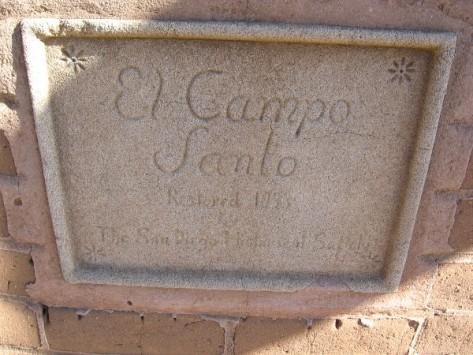 Sign in wall that encloses El Campo Santo.