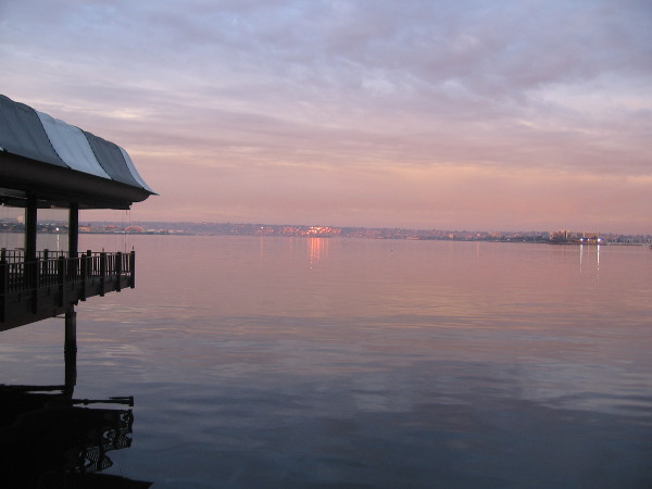 January sunrise tints calm water of San Diego Bay.