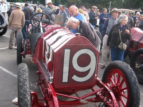 Someone checks out Fiat racing car at special Balboa Park Centennial event.