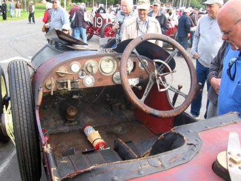 Wooden dashboard full of knobs looks almost prehistoric compared to modern cars!