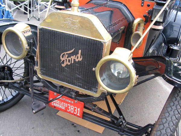 Here's the grill of a cool Ford. License plate is for a Horseless Carriage.