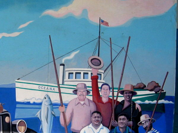 Part of the fun mural shows fishermen with a big catch.