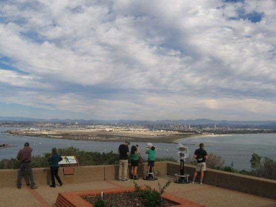 People on patio behind Visitor Center take in a breathtaking panorama.