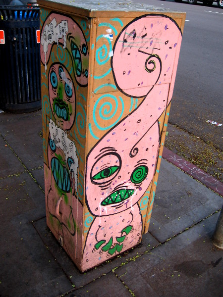 Pink monster with messed up green eyes.