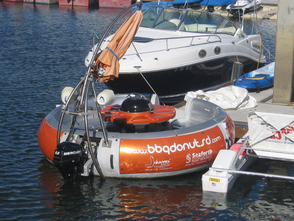 This crazy boat shaped like a donut features a huge central barbeque!
