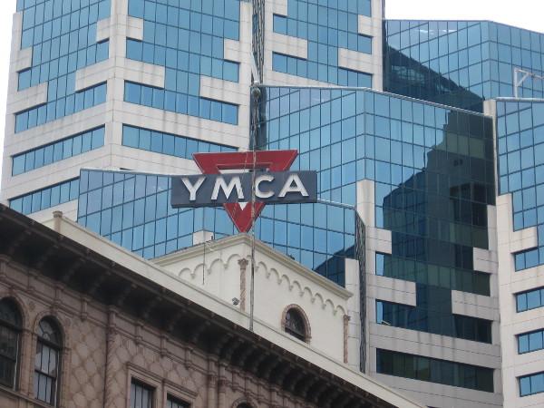 YMCA sign atop building near Emerald Plaza.