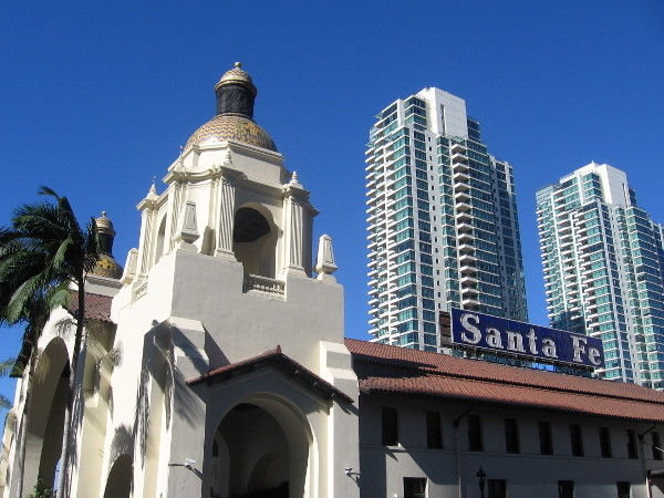Buildings rise behind the domes of the Santa Fe Depot.