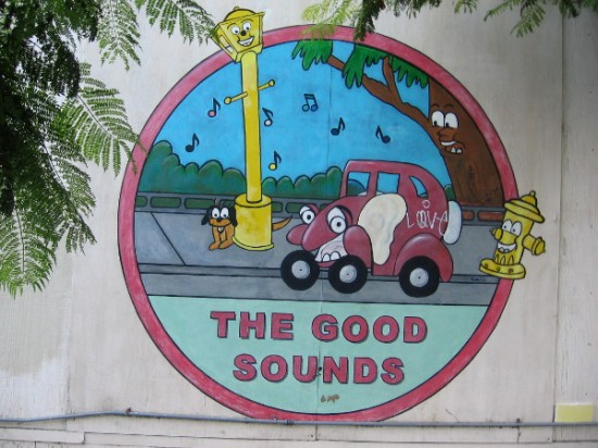 Fun image on wall of The Good Sounds car stereo installation shop.