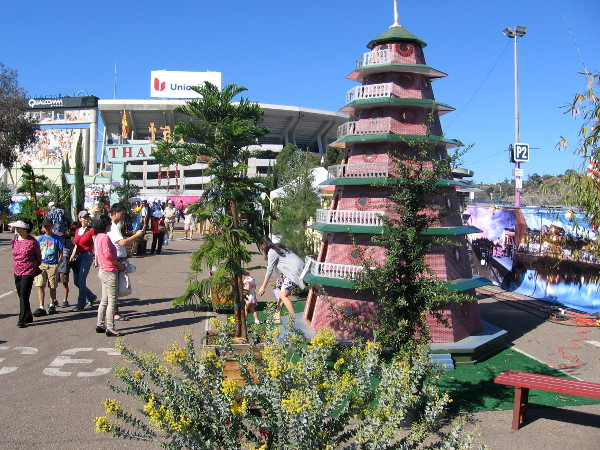 People check out colorful displays after entering the annual festival on a sunny weekend.