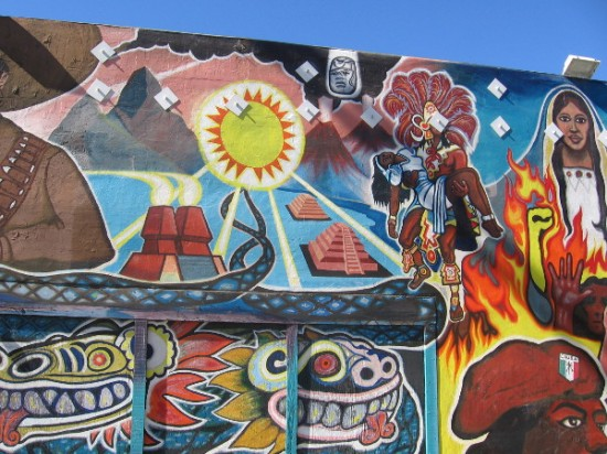Sun shines on dynamic mural at Golden Hill Market and Liquor in Sherman Heights.