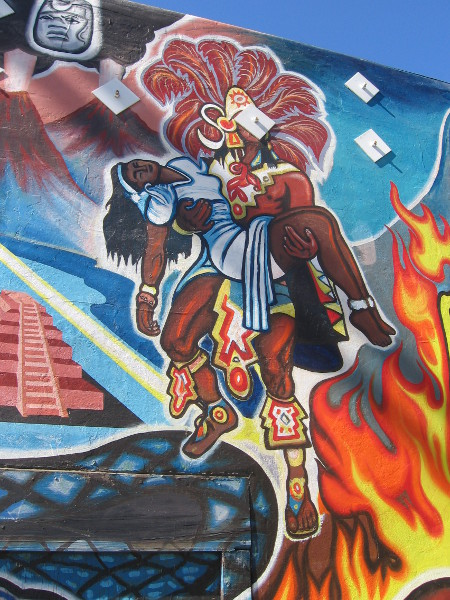 Aztec imagery is a colorful part of the artwork.