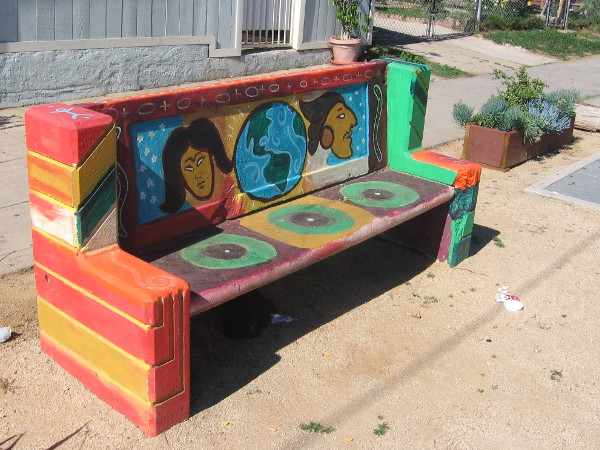 Brightly painted street bench on 25th Avenue in Sherman Heights.