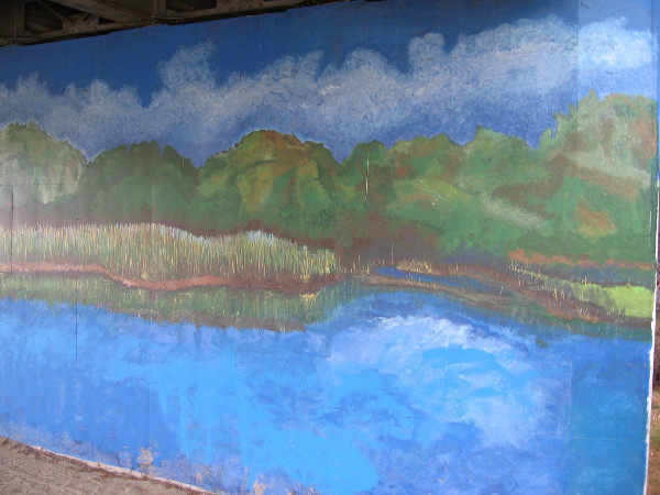 Second mural painted on south side of Friars Road also shows a river scene.