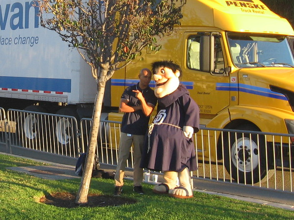 San Diego Padres baseball mascot Swinging Friar near truck about to leave for Peoria.