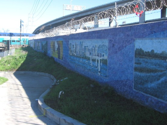 Public art along the San Diego River Trail near Pacific Highway. The Coaster train can be seen passing across one of the rail bridges.