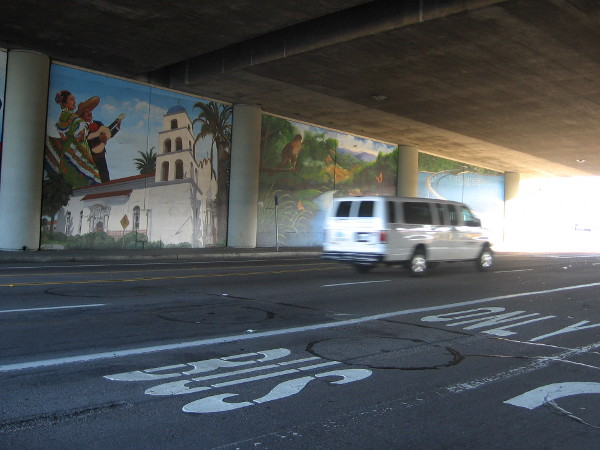 Four large works of art can be glimpsed by motorists as they drive under the busy overpass.