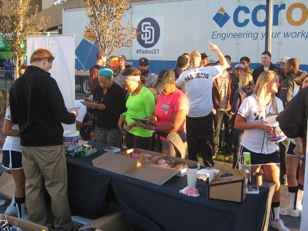 Diehard fans enjoy morning donuts and other goodies courtesy of the Padres.