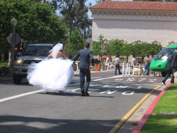 New bride and groom hustle through the heart of Balboa Park.