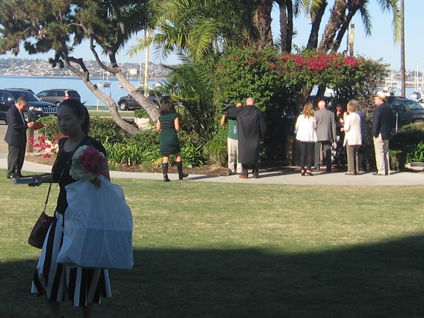 The first ceremony takes places at the small wedding arbor in the waterfront park.
