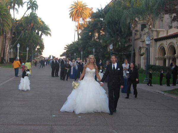 Wedding party walks down elegant El Prado, a frequent sight in Balboa Park.