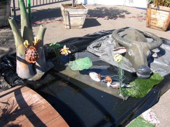 Art on display near entrance includes water buffalo and flowers.