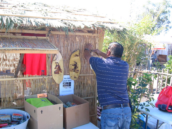 Getting a bamboo cottage house ready for a throng of festival visitors.