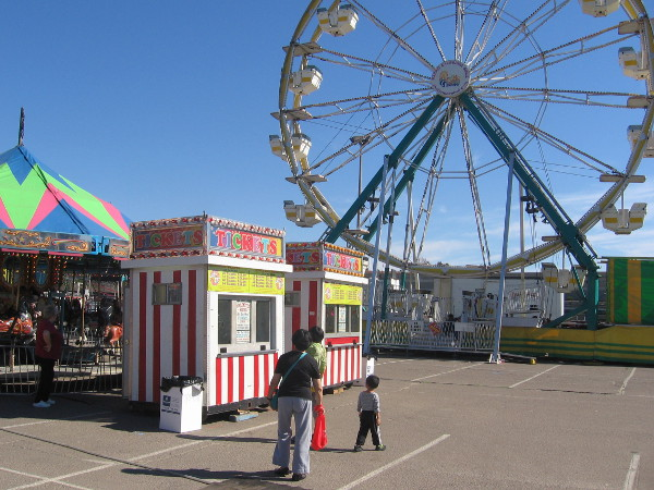 A big carnival area includes a Ferris wheel.