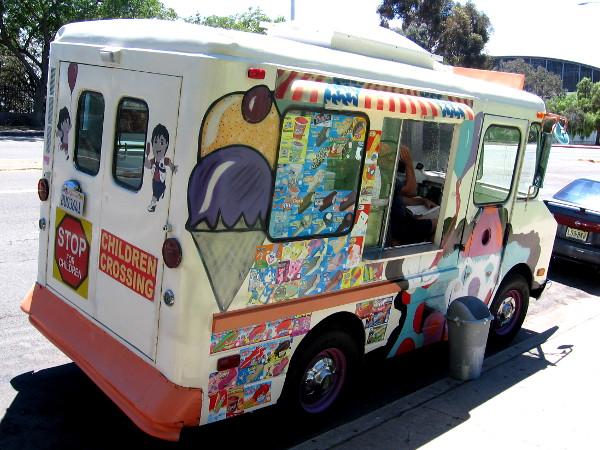 Ice cream truck parked by children's playground on Park Boulevard.