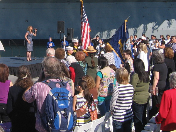 The Star Spangled Banner is sung as audience listens on San Diego's Embarcadero.