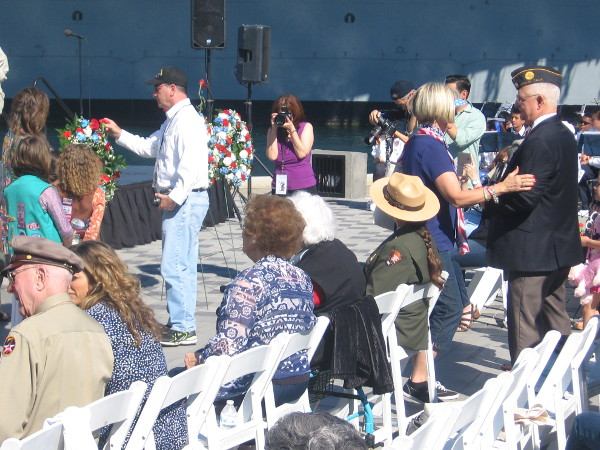 Everybody attending is invited to insert a flower, to honor those who served their country in World War II.