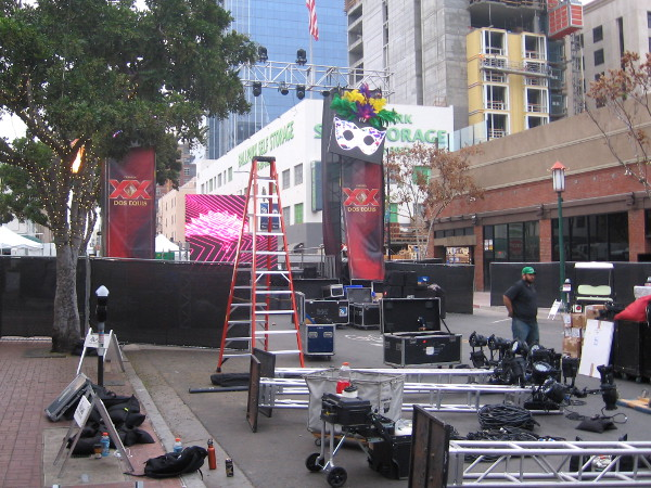Workers set up and test electronic video displays for the evening festivities.