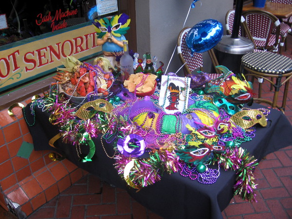 A table brimming with colorful masks and beads.