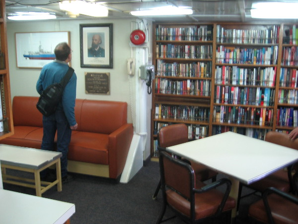 The library, lounge and study contain shelves of books and several interesting displays.