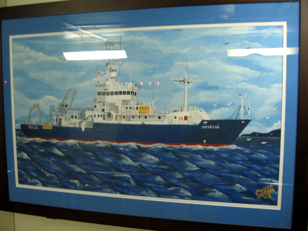 Painting by artist Chuzo of the Melville hangs in a corridor near some stairs below deck.